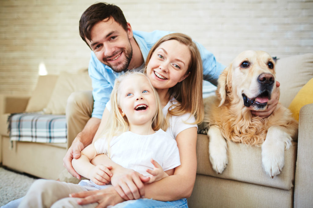 Happy family having home rest with their pet
